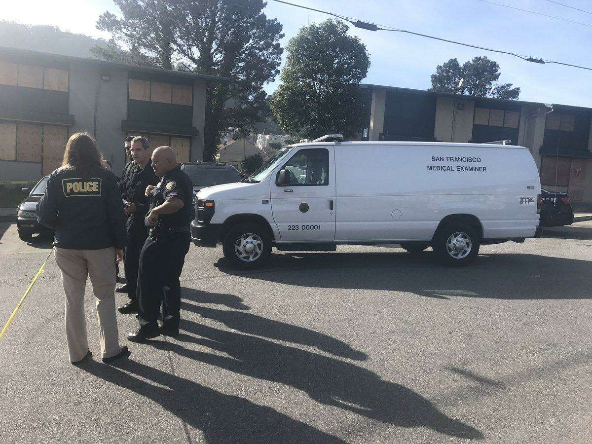 City medical examiner's office van parked at the scene of an officer-involved shooting in the Bay View neighborhood of San Francisco on Friday morning.
