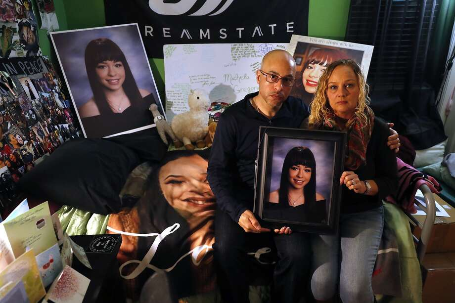 David and Kim Gregory hold a picture of their 20-year-old daughter, Michela, in her bedroom, which they have kept intact in their South San Francisco home since her death. Photo: Scott Strazzante, The Chronicle