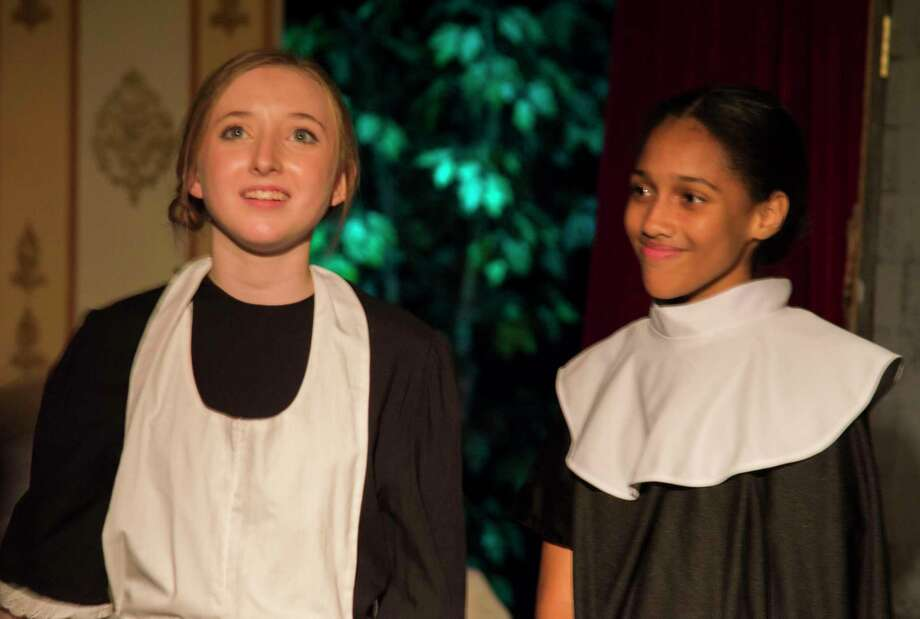 """Paige Heyl and Alyssa Dennis portray Maria and Mother Abbess during the Kingwood Middle School fall production of """"The Sound of Music."""" Photo: Jim Snyder"""