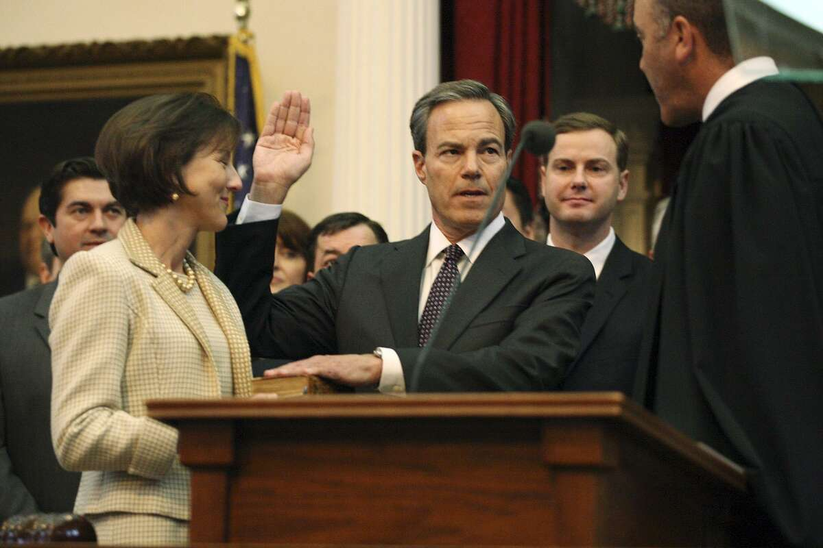 Representative Joe Straus is sworn in as Speaker of the House by Texas Supreme Court Chief Justice Wallace B. Jefferson after the 83rd Texas Legislature convened at the State Capitol in Austin, Tuesday, Jan. 8, 2013. With Straus is his wife, Julie.