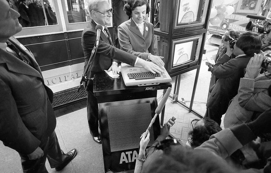 Mayor Dianne Feinstein accepts $1 million from the Atari Corp. on March 9, 1982 -- the video game company gave the money to save the cable cars. Photo: Steve Ringman, The Chronicle