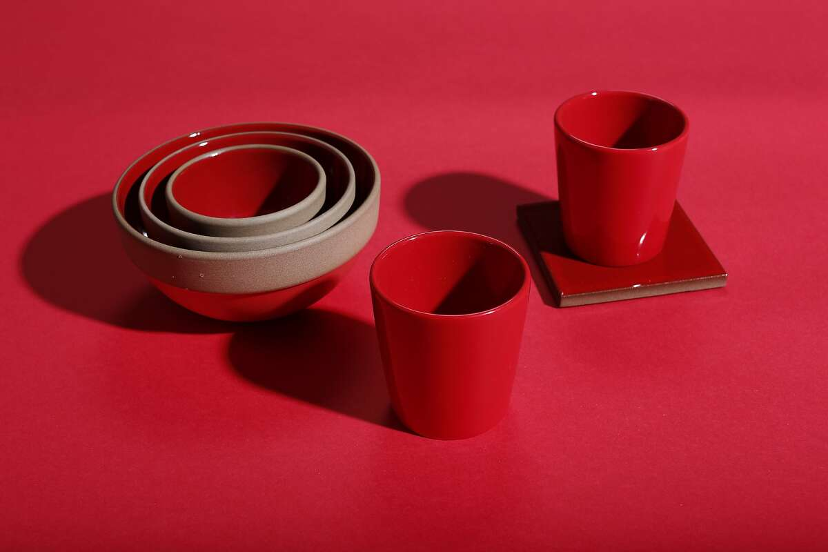 Heath Classic Red Collection: holiday tile coasters, set of four, $48; rim nesting bowl set, $90; Heath Ceramics, 2900 18th St., www.heathceramics.com; red glasses (part of the Vin Eau Carafe; not sold separately), $35, Fine Arts Museums of San Francisco, www.shop.famsf.org.