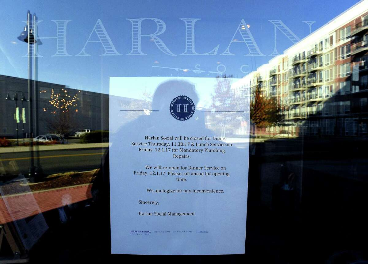 A letter from the owners of Harlan Social is posted on the entrance to the South End restaurant on Friday, Dec. 1, 2017. The Stamford Health Department recently closed the Stamford, Conn. restaurant as they make repairs to plumbing and loss of hot water.