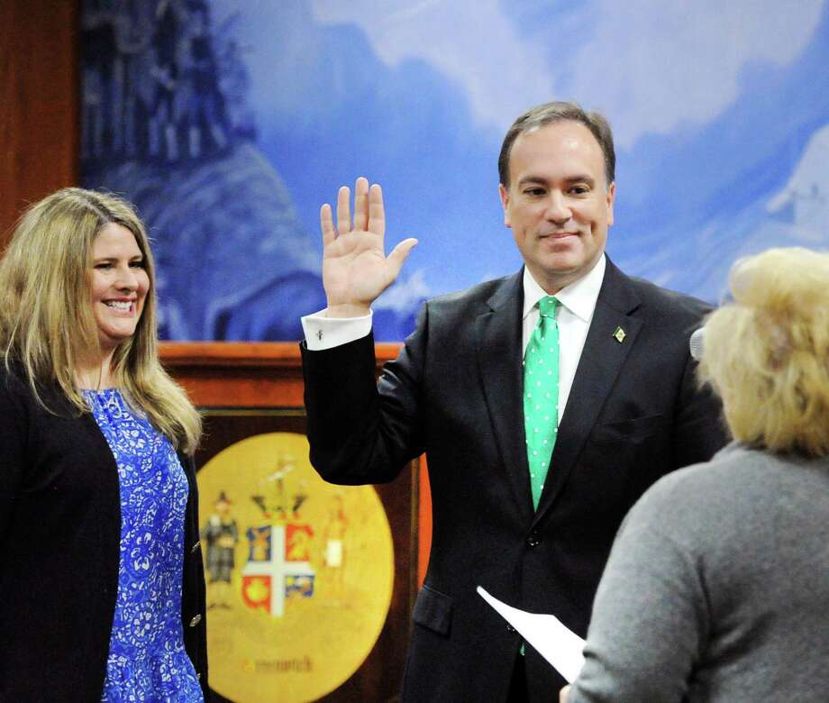 With his wife Jill Tesei looking on at left, Greenwich First Selectman Peter Tesei, a Republican, is sworn-in to serve his sixth term as Greenwich First Selectman during the Town of Greenwich Board of Selectmen swearing-in ceremony at Greenwich Town Hall, Conn., Friday, Dec. 1, 2017. Photo: Bob Luckey Jr. / Hearst Connecticut Media / Greenwich Time