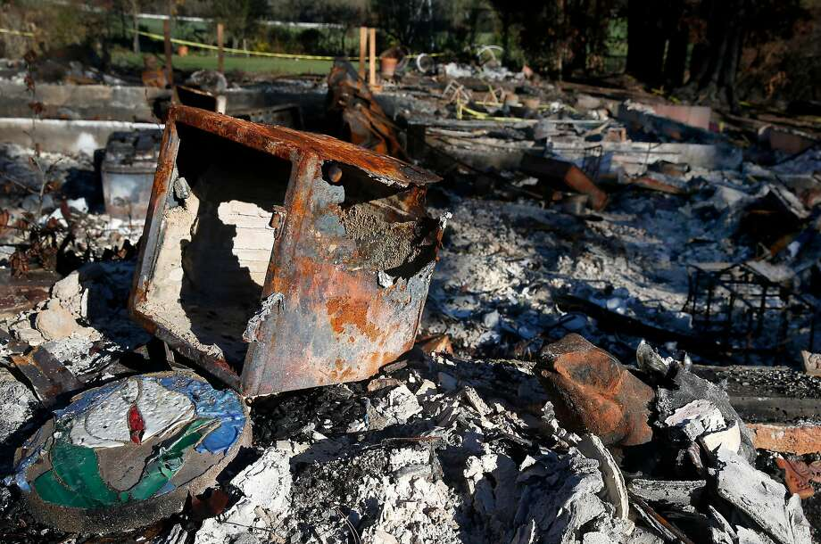 The fire safe that Matthew and Coby Stockton owned for important documents lies among the debris of their Santa Rosa home. Photo: Paul Chinn, The Chronicle