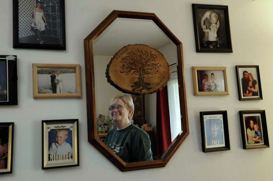 Kathy Sivertsen, 69, is the president of the resident association at Butter Brook Hill Apartments in New Milford, where many are concerned about the state budget. A hobby is geneology and she surrounds herself with family photos in her living room. Photo Friday, Dec. 1, 2017. Photo: Carol Kaliff / Hearst Connecticut Media / The News-Times