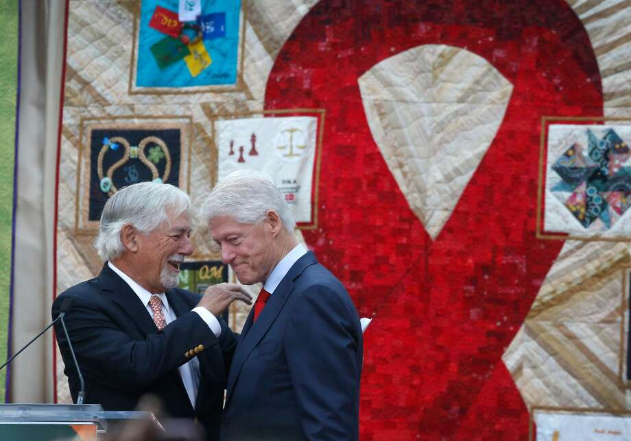 Above: Mark Buell, activist and major Democratic Party fundraiser, with former President Bill Clinton, who delivers the keynote address to commemorate World AIDS Day. Below: Judy Fox is in the audience at the grove in Golden Gate Park. Photo: Paul Chinn, The Chronicle