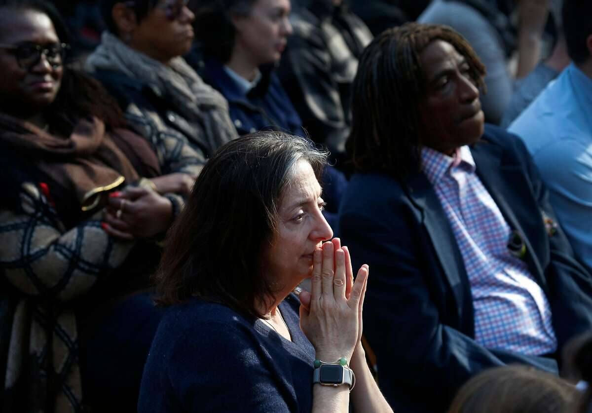 Judy Fox listens to former President Bill Clinton deliver the keynote address to commemorate World AIDS Day at the National AIDS Memorial in Golden Gate Park in San Francisco, Calif. on Friday, Dec. 1, 2017.