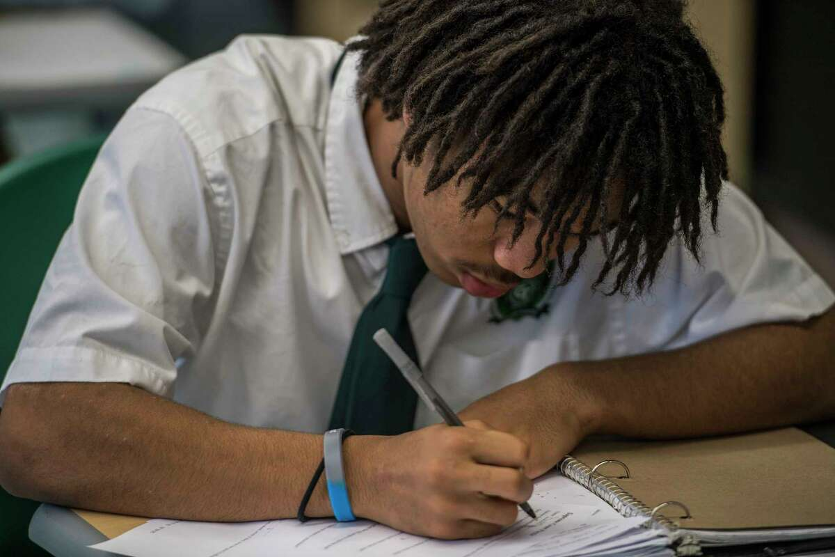 A student works intently on his classwork during a government class at the Green Tech High Charter School Thursday Nov. 30, 2017 in Albany, NY. A new analysis shows charter schools are among the most racially segregated in the nation, but many say thatOs not a bad thing so long as they produce results. Green Tech High Charter School, pictured here, has a student body thatOs 97 percent black, but consistently produces the highest academic outcomes in the Albany City School District. (Skip Dickstein/ Times Union)