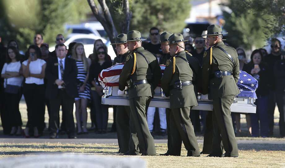 Border Patrol pallbearers carry Border Patrol agent Rogelio Martinez to a graveside service at Restlawn Cemetery, Saturday, Nov. 25, 2017 in El Paso, Texas. Martinez was on patrol in the Big Bend Sector when he died in the line of duty. (Mark Lambie/The El Paso Times via AP) Photo: Mark Lambie, Associated Press