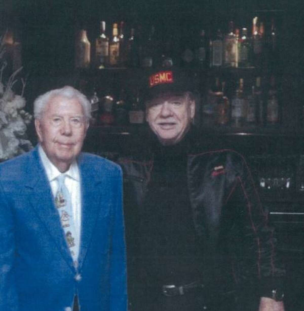 Mort Walkter (left) and Stewart Jacobson (right) at a Toys for Tots lunch at the 21 Club in New York City in 2015.