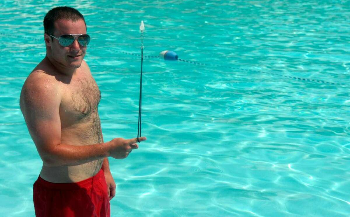 """Chris Fracker, 21, Trumbull town pool lifeguard: """"America means hot dogs, hamburgers and a long day at the pool."""""""