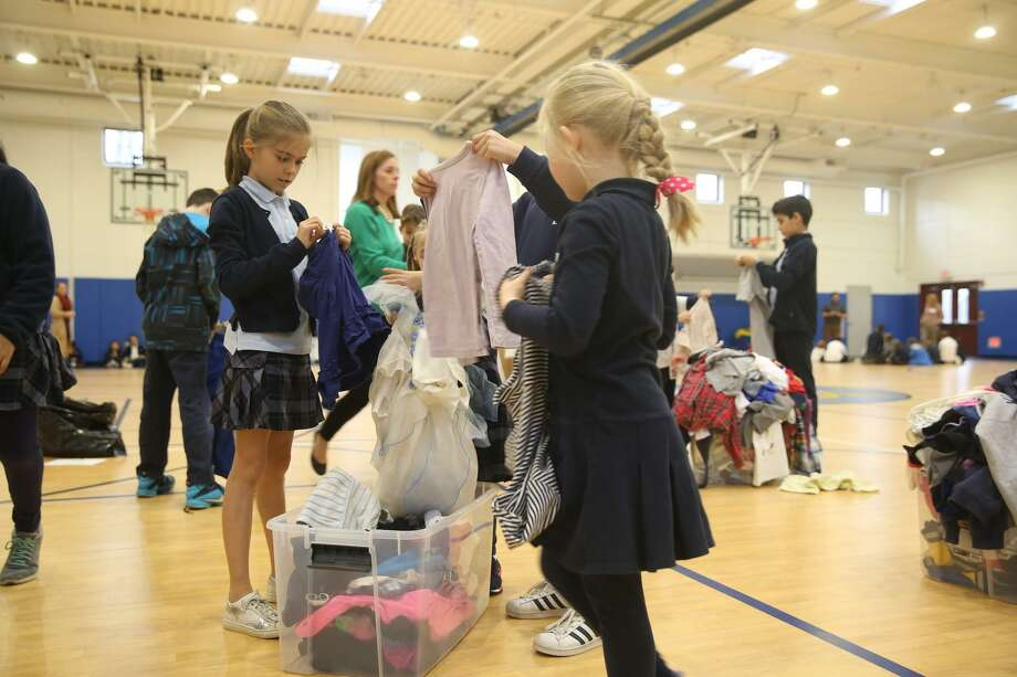 (L to R)Whitby studentsfFifth grader Elise Bruyland sorted clothing with kindergartner Emilia Sandomierz on Nov. 30. Photo: Contributed