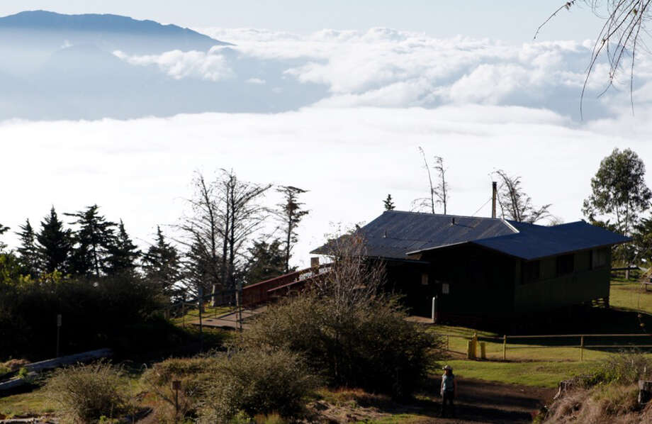 A cabin in Maui's Polipoli Spring State Recreation Area affords a view across the island's isthmus to the West Maui Volcano. Photo: Photo By John Briley For The Washington Post. / For The Washington Post