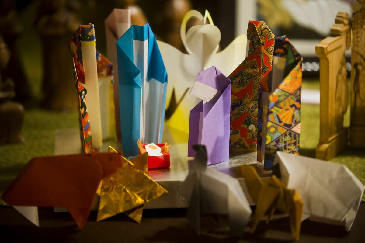 An origami nativity scene from Japan is one of more than 900 nativities on display at the Church of Jesus Christ of Latter-day Saints on Friday. The exhibit is open Friday, Dec. 1 through Sunday, Dec. 3, 2017 from 11 a.m. until 9 p.m. Admission is free. (Katy Kildee/kkildee@mdn.net)