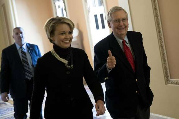 Senate Majority Leader Mitch McConnell, a Republican from Kentucky, gives a thumbs up while walking to the Senate floor at the U.S. Capitol in Washington, D.C., U.S., on Friday, Dec. 1, 2017. The Senate�tax�bill�is headed for a round of marathon votes Friday with the goal of holding a final vote by the end of the work week.�Photographer: Aaron P. Bernstein/Bloomberg