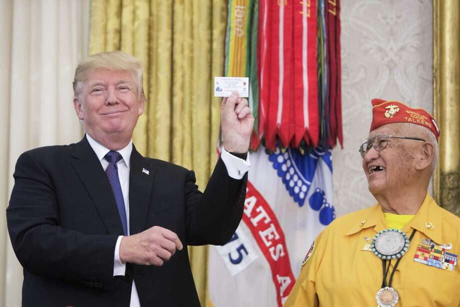 President Donald Trump with Thomas Begay, a Navajo Code Talker, during an event at the White House Nov. 27. Trump used the White House event honoring Navajo veterans of World War II to utter a favorite Native American-related insult of a political opponent, deriding Sen. Elizabeth Warren (D-Mass.) as Pocahontas. Photo: TOM BRENNER /NYT / NYTNS