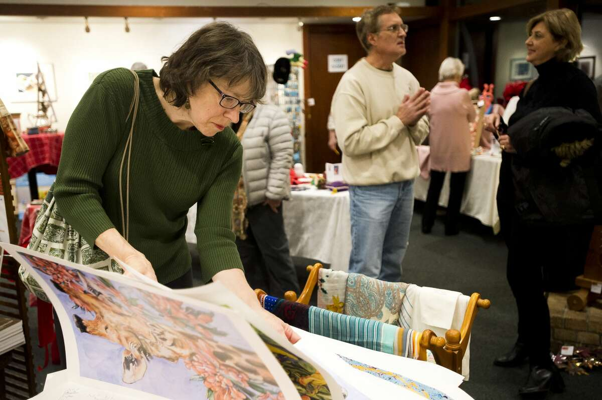Cindy LeVasseur of Midland looks through prints during a Second Hand Picasso fundraising sale at Creative 360 on Thursday, Nov. 29, 2017. The sale continues through Dec. 20. (Katy Kildee/kkildee@mdn.net)