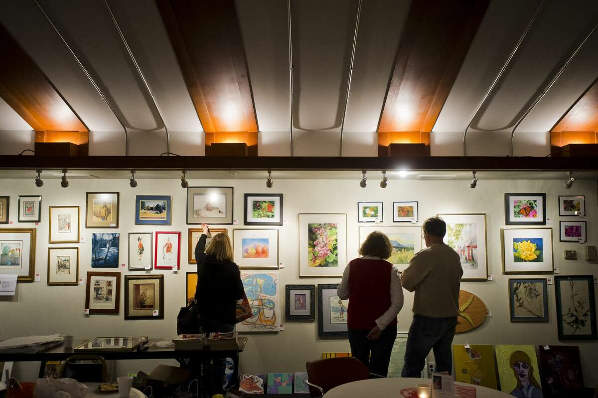People peruse artwork during a Second Hand Picasso fundraising sale at Creative 360 on Thursday, Nov. 29, 2017. The sale continues through Dec. 20. (Katy Kildee/kkildee@mdn.net)
