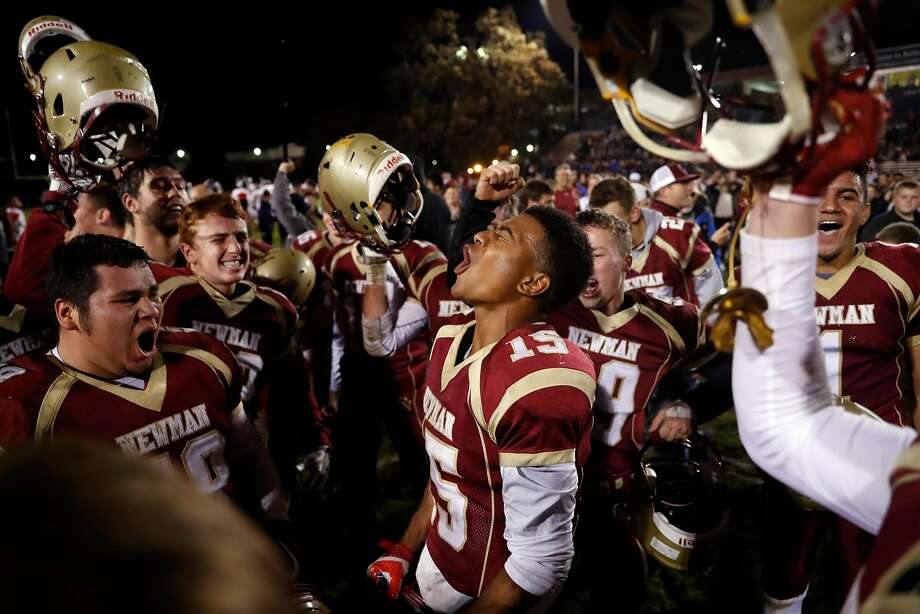 Cardinal Newman's Nikko Kitchen (center) was among the school's players who lost their homes in the North Bay wildfires. Photo: Scott Strazzante, The Chronicle