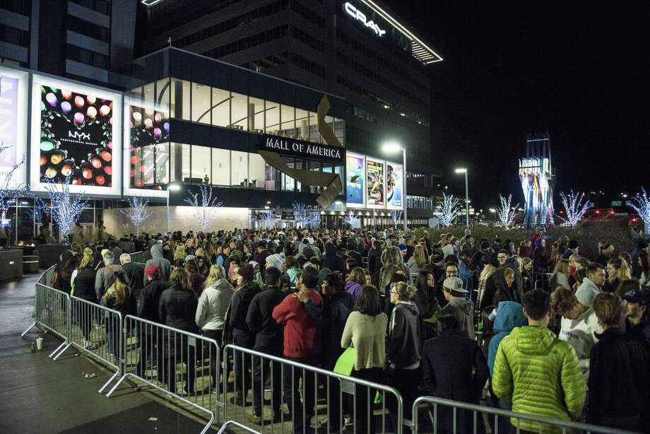 """Shoppers line up for Black Friday outside the Mall of America in Bloomington, Minn. All the pushing and pulling common on the biggest shopping day of the year reflects a society that has forgotten the meaning of the term """"polite."""" Photo: Stephen Maturen /Getty Images / 2017 Getty Images"""