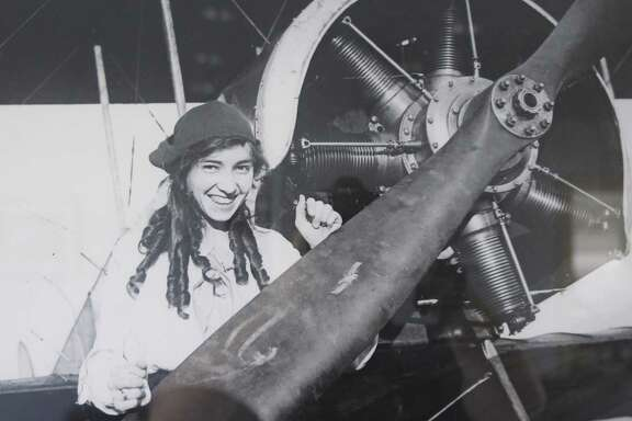 A copy of a 1916 photo hanging in the Stinson Municipal Airport terminal shows Katherine Stinson standing next to a plane at what was then Stinson Field.