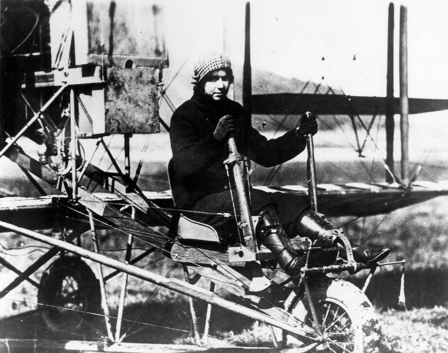 Katherine Stinson sits in her Wright B, circa 1914. Stinson was the fourth woman to qualify for a U.S. pilot's license and participated in barnstorming exhibitions. Photo: Express-News Archives