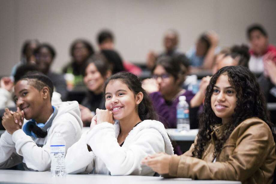 """In Houston, Hastings High School students (left to right) Tristan Applewhite, 14, Karla Mejia, 14, Mar Hinestroza, 15, listen to the physicians talk about their journey to medical school during the """"Mentoring to Medicine"""" program presented by the 100 Black Men of America, Houston Metropolitan Chapter last month. Mentoring is key to a community's ability to grow its next generation of leaders. Photo: Marie D. De Jesus /Houston Chronicle / © 2017 Houston Chronicle"""
