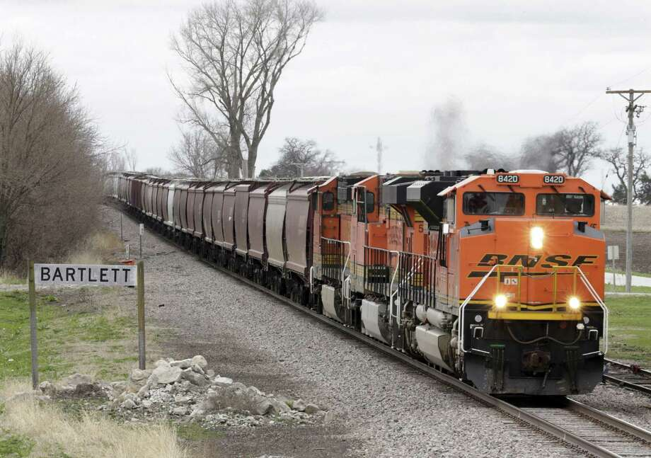 A BNSF Railway train transporting grain passes through Bartlett, Iowa in April. In 2016, the U.S. ran a more than $20 billion trade surplus in agricultural products. NAFTA has widened access to Mexican and Canadian markets, boosting U.S. farm exports and benefiting many farmers. Photo: Nati Harnik /Associated Press / Copyright 2017 The Associated Press. All rights reserved.