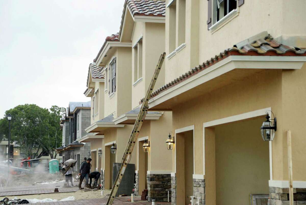 FILE - In this Thursday, Sept. 22, 2016, file photo, Lennar Corporation town homes are under construction at Chelsea Place in Tamarac, Fla. On Monday, Nov. 27, 2017, the Commerce Department releases new home sales for October. (AP Photo/Lynne Sladky, File)