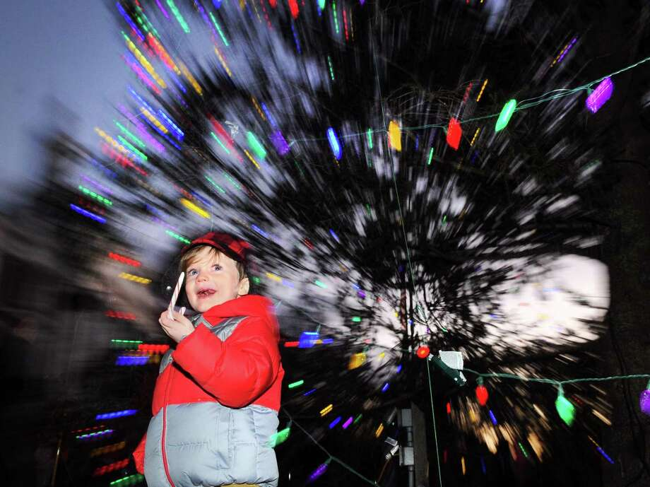 Tyson Long, 3, of Greenwich, munched on a Candy-cane as the holiday tree was lighted during the annual Town of Greenwich holiday tree lighting ceremony outside of Town Hall in Greenwich, Conn., Friday, Dec. 1, 2017. The Greenwich High School Chamber Singers performed holiday classics as Santa, Rudolph the Red-Nosed Reindeer and Frosty the Snowmam kept the children in the holiday spirit. Around 500 people attended the event. Photo: Bob Luckey Jr. / Hearst Connecticut Media / Greenwich Time