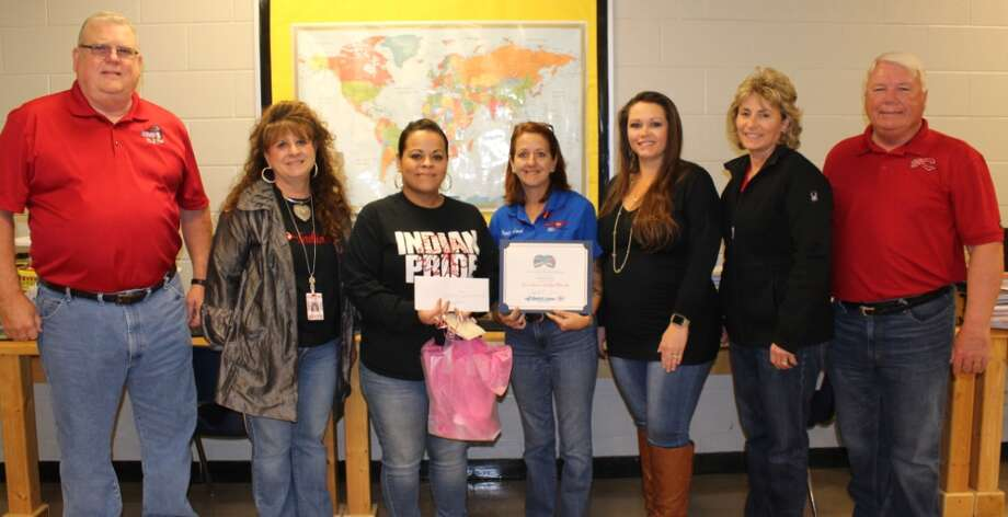 Sandy Rivas accepts congratulations for being named Cleveland ISD Teacher of the Week. She is pictured third from the left with Jeff McClain with KORG 95.3 FM, CMS Instructional Specialist Pattie Myers, Peggy Land with Quick Lane Tire and Auto, Angela Onken with Anderson Ford, CISD Deputy Superintendent Pennee Hall and CISD Superintendent Dr. Darrell Myers. Photo: Submitted