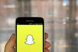 Snapchat application on android smartphone (Dreamstime/TNS)
