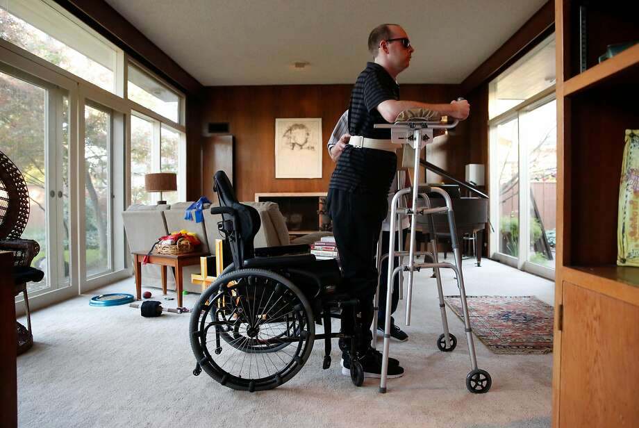 Sam Maxwell does physical therapy with the help of his caregiver in Stockton as he recovers from injuries suffered in the Ghost Ship fire a year ago in Oakland. Photo: Michael Macor, The Chronicle