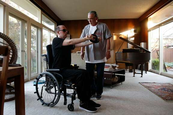 Sam Maxwell on Wednesday November 29, 2017, works physical therapy with his caregiver Ernest Mena. Maxwell is thought to be the last person to make it out of the Ghost Ship alive.  A year after the fire, he's currently re-learning how to talk and walk, at his parents house in Stockton, Calif.