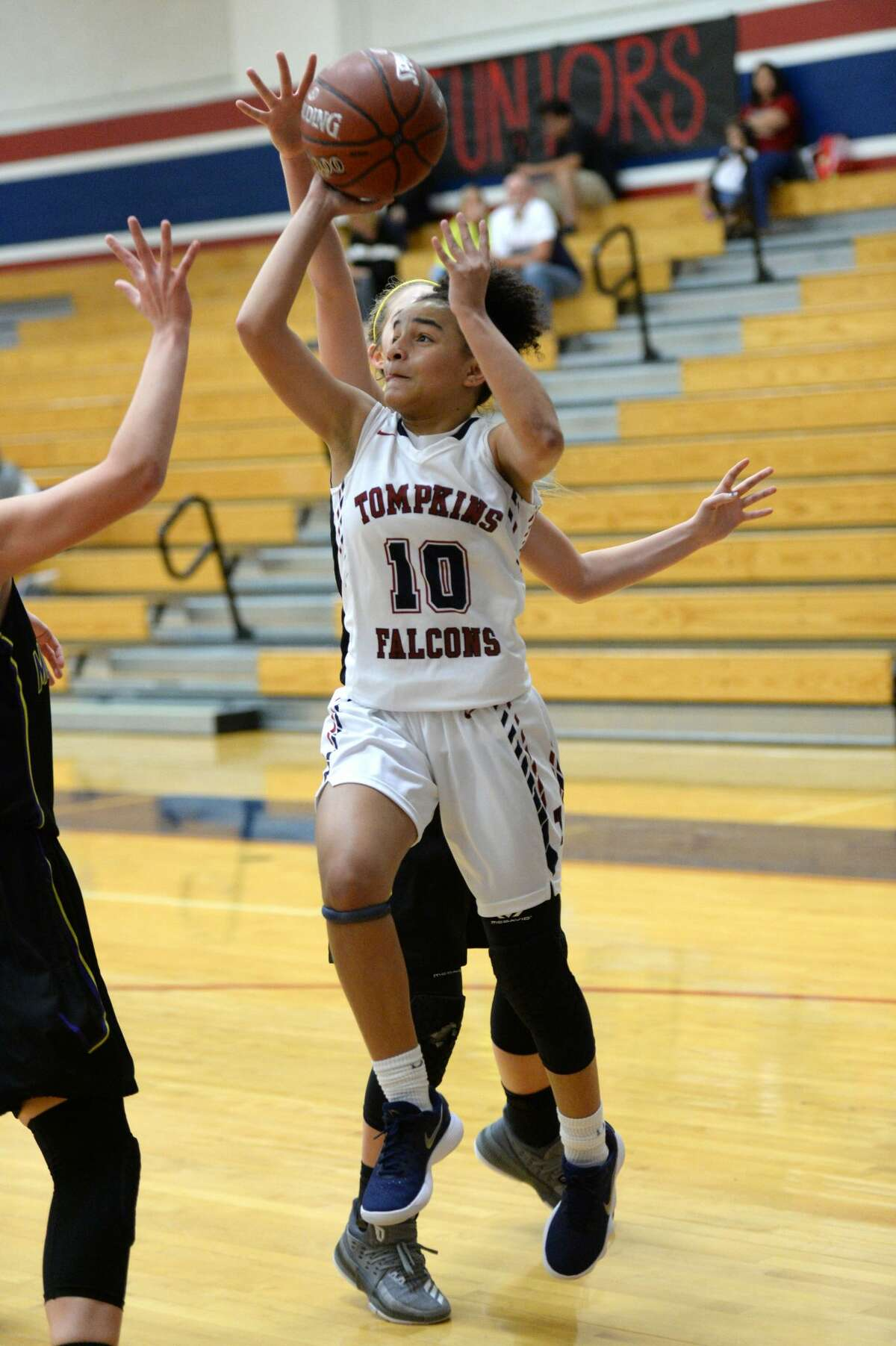 Nalani Burton (10) of Tompkins drives to the hoop during a first round game in the Phillips 66 Katy Classic between the Tompkins Falcons and the Montgomery Bears on Thursday November 30, 2017 at Tompkins HS, Katy, TX.