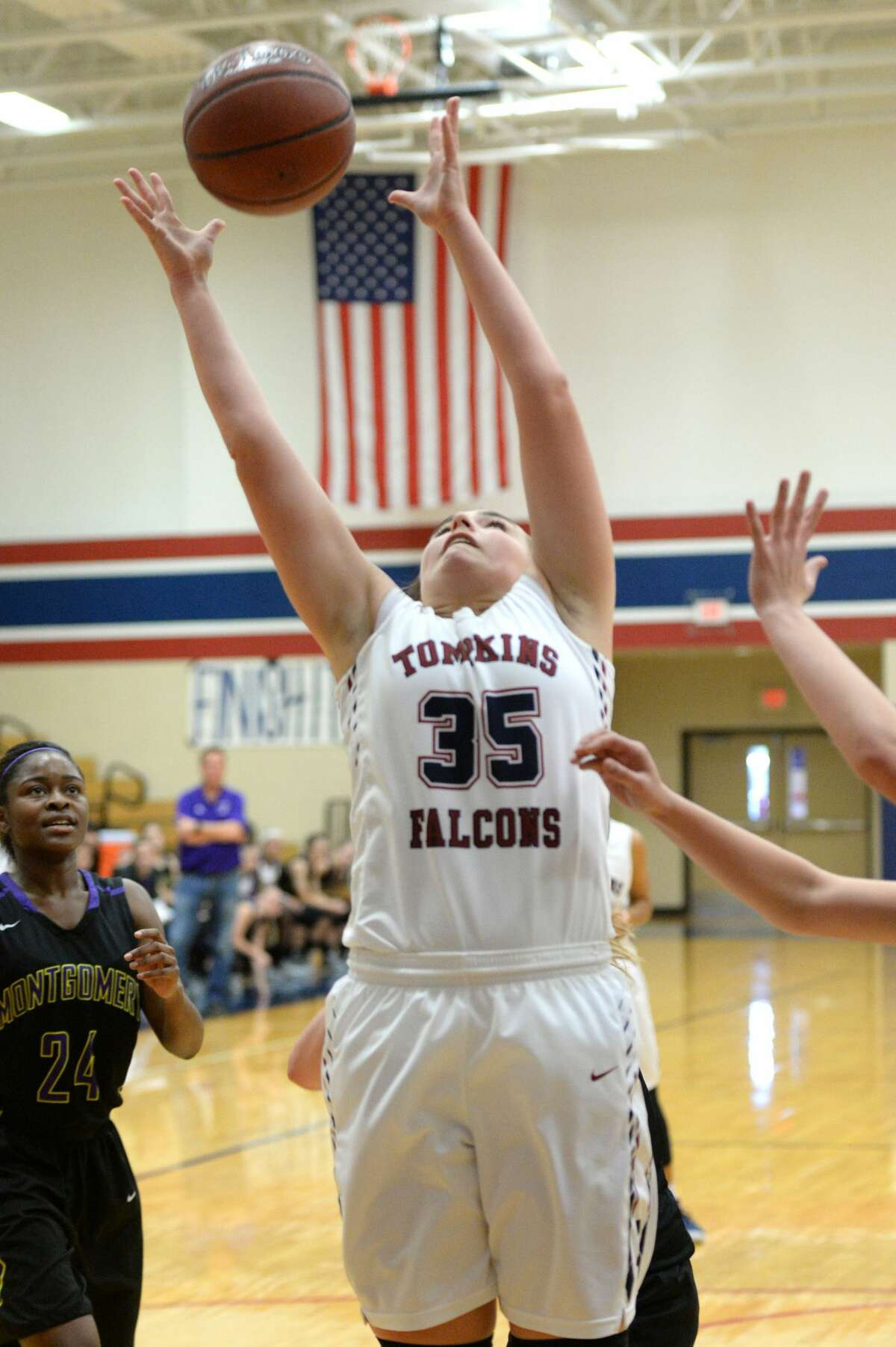 Erin Beaird (35) of Tompkins grabs a rebound during a first round game in the Phillips 66 Katy Classic between the Tompkins Falcons and the Montgomery Bears on Thursday November 30, 2017 at Tompkins HS, Katy, TX.