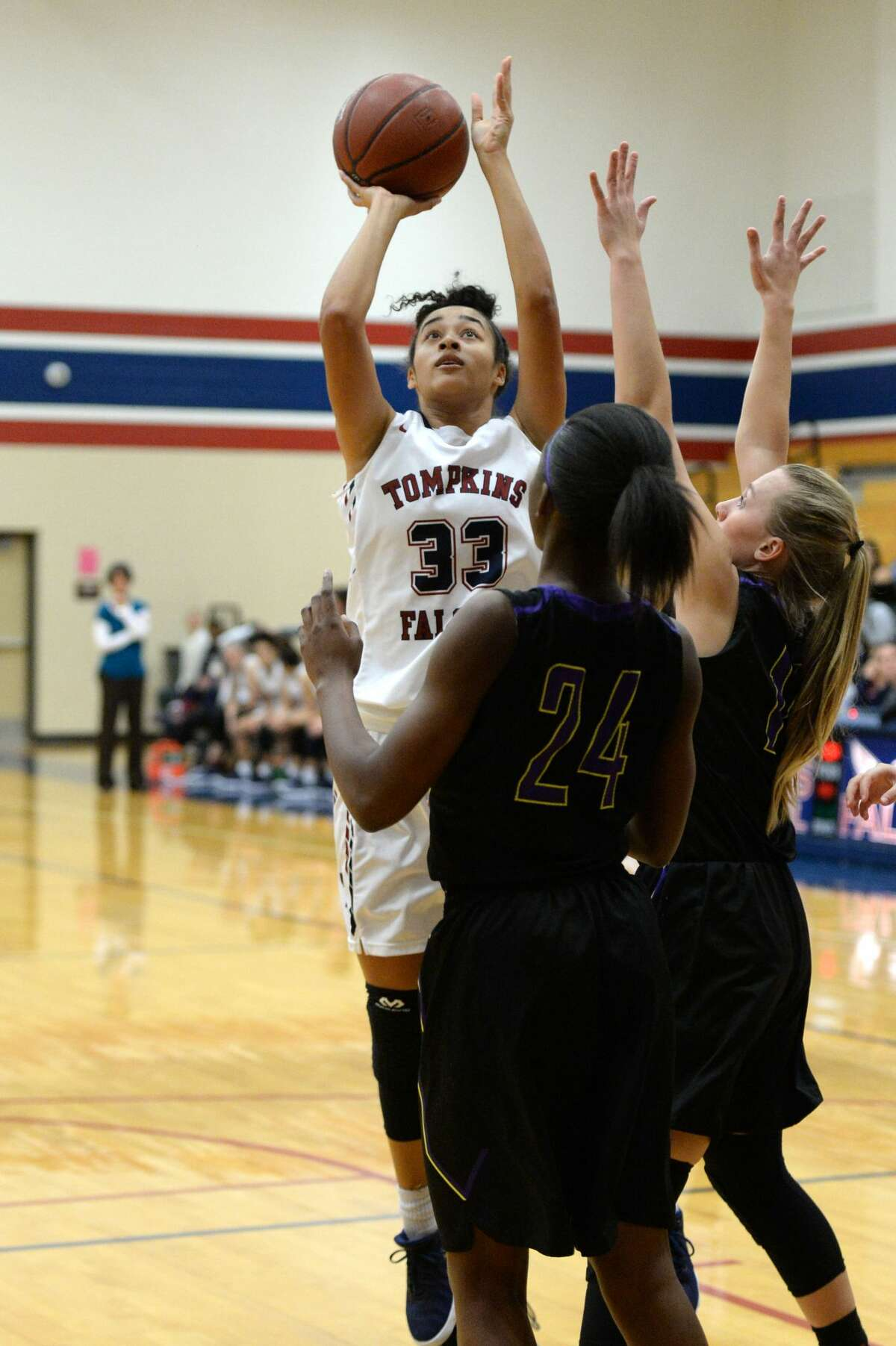 PHOTOS: Tompkins vs. Montgomery Mia Hill (33) of Tompkins takes a shot during a first round game in the Phillips 66 Katy Classic between the Tompkins Falcons and the Montgomery Bears on Thursday November 30, 2017 at Tompkins HS, Katy, TX.