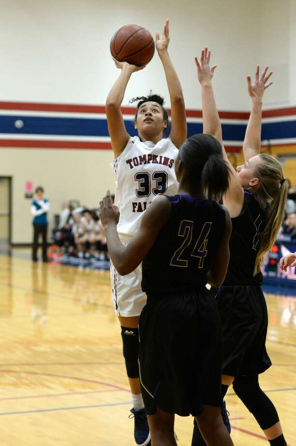 PHOTOS: Tompkins vs. MontgomeryMia Hill (33) of Tompkins takes a shot during a first round game in the Phillips 66 Katy Classic between the Tompkins Falcons and the Montgomery Bears on Thursday November 30, 2017 at Tompkins HS, Katy, TX. Photo: Craig Moseley/Houston Chronicle