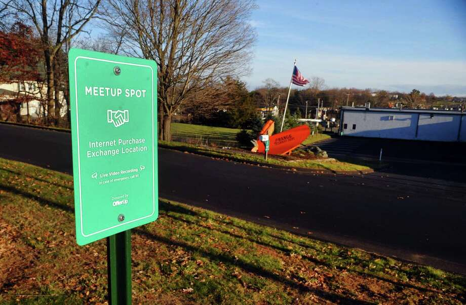 A view of the Meetup Spot sign placed in the parking lot of the Orange Police Department in Orange, Conn., on Thursday Nov. 30, 2017. With the holiday season already upon us, many people will look to websites like OfferUp, Craigslist, LetGo, or Facebook to buy/sell things. This offers sellers and buyers a safe spot to meet and do their business without fear of being robbed or scammed. Photo: Christian Abraham / Hearst Connecticut Media / Connecticut Post