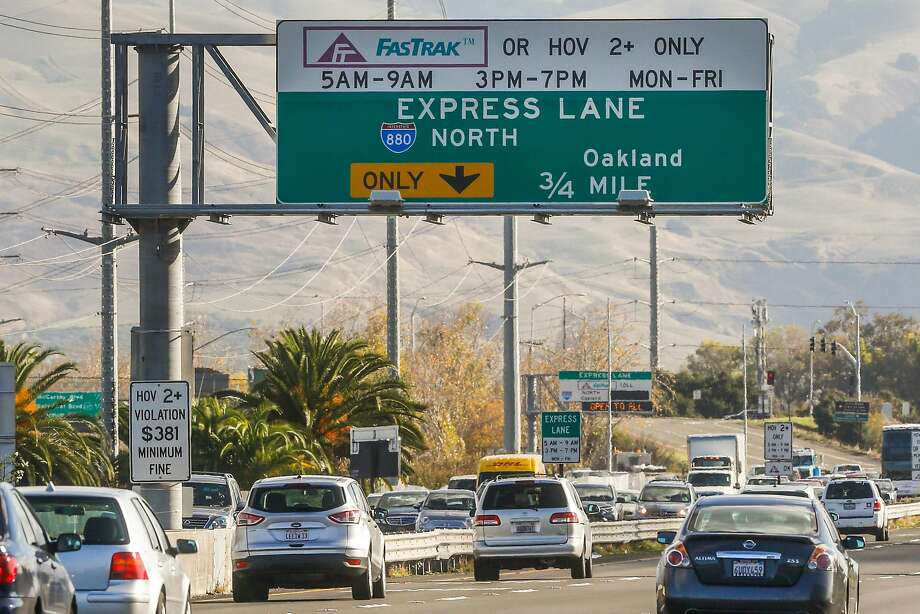 Morning commuters drive past a sign for an express lane on the Interstate 880-Highway 237 interchange in Milpitas. In their first full year, the 580 lanes produced more than $9 million in net revenue from tolls. By comparison, the Interstate 880-Highway 237 express lanes recorded $405,000 in net revenue. Photo: Gabrielle Lurie, The Chronicle