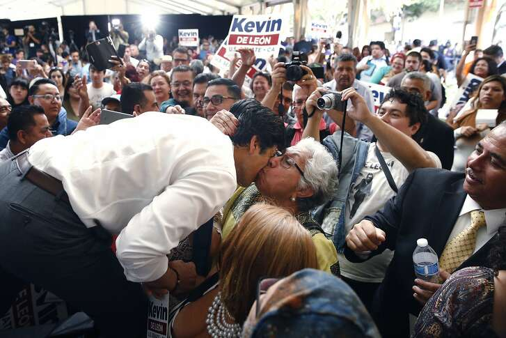 State Sen. Kevin de Leon, left, gets a kiss from a supporter during an event held to formally announce his run for U.S. Senate Wednesday, Oct. 18, 2017, in Los Angeles. (AP Photo/Jae C. Hong)