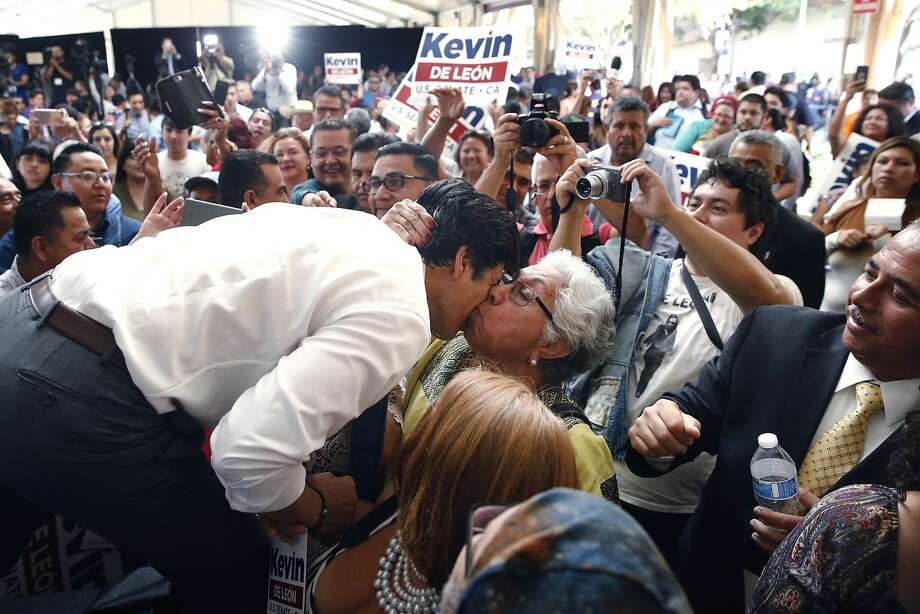 State Sen. Kevin de Leon, left, gets a kiss from a supporter during an event held to formally announce his run for U.S. Senate Wednesday, Oct. 18, 2017, in Los Angeles. (AP Photo/Jae C. Hong) Photo: Jae C. Hong, Associated Press