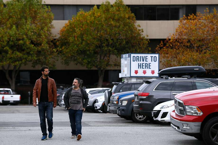 Two men walk through a parking lot at Front Street and Broadway in San Francisco, Calif. on Wednesday, Nov. 15, 2017. Supervisor Aaron Peskin is floating an idea to open two homeless navigation centers at Pier 23 and on a parking lot at 88 Broadway. Photo: Paul Chinn, The Chronicle