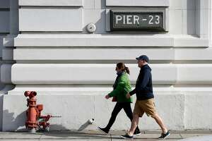Pedestrians stroll past Pier 23 in San Francisco, Calif. on Wednesday, Nov. 15, 2017. Supervisor Aaron Peskin is floating an idea to open two homeless navigation centers at Pier 23 and on a parking lot at 88 Broadway.