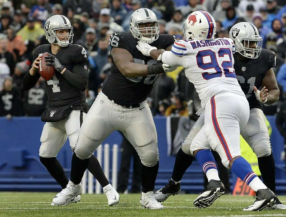 Oakland Raiders quarterback Derek Carr (4) drops back in the pocket as guard Gabe Jackson (66) blocks Buffalo Bills defensive tackle Adolphus Washington (92) during the second half of an NFL football game, Sunday, Oct. 29, 2017, in Orchard Park, N.Y. Buffalo beat Oakland 34-14. (AP Photo/Adrian Kraus) Photo: Adrian Kraus, Associated Press