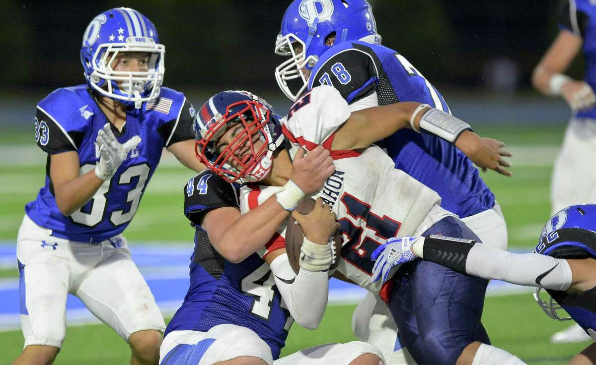Brien McMahon Chris Druin is stopped short of the first down by Darien Connor Fay in a FCIAC football game on Friday, Sept. 15, 2017 in Darien, Connecticut. Darien defeated Brien McMahon 47-0 in their first game at the school under the lights.