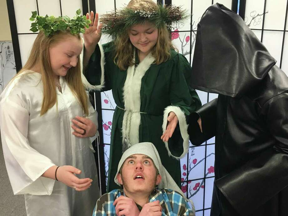 """'West Woods Christian Academy, North Haven, will present the musical """"Scrooge"""" at 7 p.m. Dec. 8, 2 p.m. Dec. 9 at Hope Christian Church, 211 Montowese Ave. Tickets, at the door, are $5 for students and $7 for adult tickets. From left,Autumn Clifford as Christmas Past, Amanda Wallace as Christmas Present, and Max Gaudio as Christmas Future, with Josh Bartholomew as Scrooge.The cast also includes Jonathan George as Bob Cratchit, Padriac Andrianoff as Fred, Jace Fredette as Tiny Tim, and Kyle August as Jacob Marley. """"Scrooge"""" is based on Charles Dickens' """"A Christmas Carol."""" Photo: Contributed Photo"""