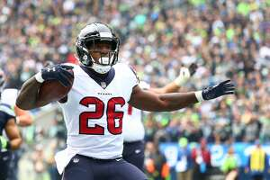 Houston Texans running back Lamar Miller (26) celebrates his 3-yard touchdown against the Seattle Seahawks during the first half of the game at CenturyLink Field Sunday, Oct. 29, 2017, in Seattle. ( Godofredo A. Vasquez / Houston Chronicle )