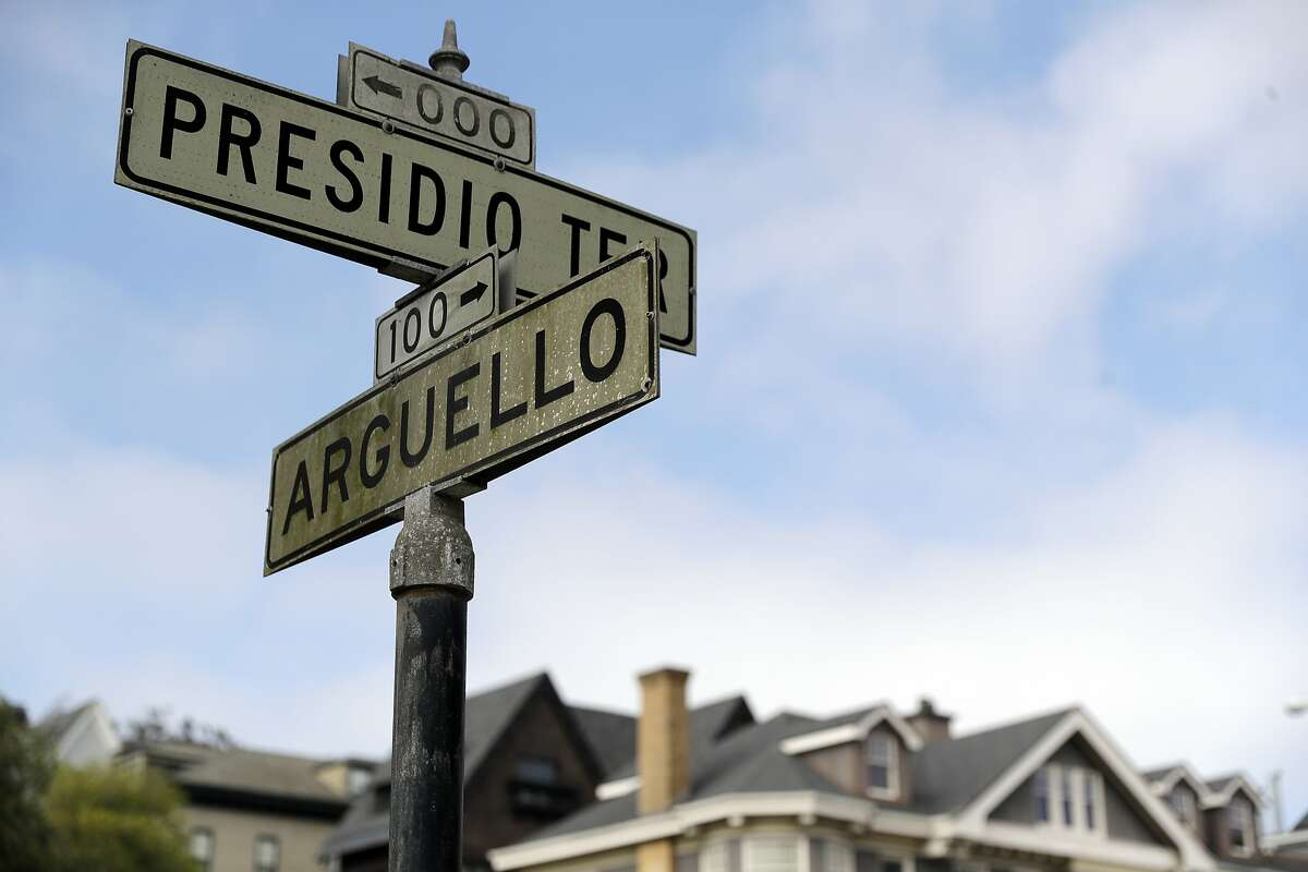 FILE - In this Aug. 7, 2017 file photo, street signs are seen at the intersection of Presidio Terrace and Arguello at the entrance to the Presidio Terrace neighborhood in San Francisco. Wealthy homeowners whose private, gated and very exclusive San Francisco street was auctioned off after decades of unpaid taxes are asking supervisors Monday, Nov. 27, 2017, to undo the sale, prompting cries of elitism in a city obsessed with property and fairness. (AP Photo/Marcio Jose Sanchez, File)
